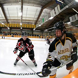 AURORA, ON - Jan 17 : Ontario Junior Hockey League Game Action between the Stouffville Spirit and the Aurora Tigers, Peyton Backus #19 of the Stouffville Spirit Hockey Club lines up the hit on Noah Delmas #12 of the Aurora Tigers Hockey Club during second period game action.<br /> (Photo by Brian Watts / OJHL Images)