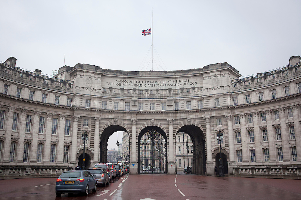 © Licensed to London News Pictures. 09/04/2013. London, UK. The Union Jack flag on the roof of Admiralty Arch in London is seen flying at half mast as a sign of respect for former British Prime Minister Baroness Thatcher who died yesterday (08/04/2013) after a stroke. Photo credit: Matt Cetti-Roberts/LNP