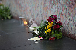 © Licensed to London News Pictures. 11/01/2016. London, UK. Floral tributes are placed at a mural to David Bowie in Brixton. The Death of David Bowie has been announced. Bowie was born in Brixton.  Photo credit: Peter Macdiarmid/LNP