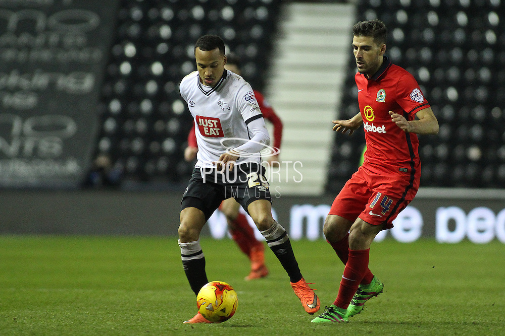 Derby County defender Marcus Olsson and Blackburn Rovers midfielder Jordi Gomez challenge for the ball during the Sky Bet Championship match between Derby County and Blackburn Rovers at the iPro Stadium, Derby, England on 24 February 2016. Photo by Aaron  Lupton.
