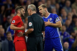 LONDON, ENGLAND - Friday, September 16, 2016: Liverpool's Adam Lallana clashes with Chelsea's Bratislava Ivanovic during the FA Premier League match at Stamford Bridge. (Pic by David Rawcliffe/Propaganda)