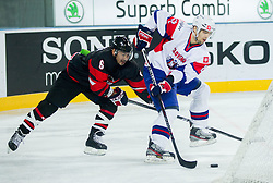 Makoto Kawashima of Japan vs David Rodman of Slovenia during ice-hockey match between Slovenia and Japan at IIHF World Championship DIV. I Group A Slovenia 2012, on April 16, 2012 in Arena Stozice, Ljubljana, Slovenia. Slovenia defeated Japan 4-2. (Photo by Vid Ponikvar / Sportida.com)