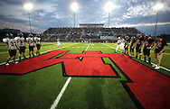 The captains on the field for the coin toss before the start of the game between Cedar Rapids Kennedy and Linn-Mar at Linn-Mar Stadium in Marion on Friday evening, September 2, 2011. It was 35-7 Linn-Mar at halftime.