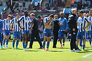 Brighton players look dejected at the final whistle of the EFL Sky Bet Championship match between Aston Villa and Brighton and Hove Albion at Villa Park, Birmingham, England on 7 May 2017.