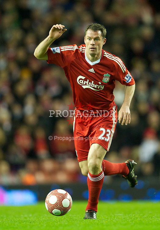 LIVERPOOL, ENGLAND - Monday, March 15, 2010: Liverpool's Jamie Carragher in action against Portsmouth during the Premiership match at Anfield. (Photo by: David Rawcliffe/Propaganda)