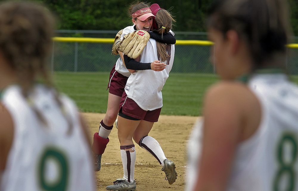 (061106-Taunton, MA)  At center, West Bridgewater's Jessie Russell, #7, hugs Kellie Burley, #14, after their win against Greater New Bedford Voc Tech in their Division 3 South final game Sunday afternoon at Taunton High School, in which the West Bridgewater Wildcats won 1-0.