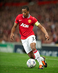 27.09.2011, Old Trafford, London, ENG, UEFA CL, Gruppe C, Manchester United (ENG) vs FC Basel (SUI), im Bild Manchester United's captain Patrice Evra in action against FC Basel 1893 // during the UEFA Champions League game, group C, Manchester United (ENG) vs FC Basel (SUI) at Old Trafford stadium in London, United Kingdom on 2011/09/27. EXPA Pictures © 2011, PhotoCredit: EXPA/ Propaganda Photo/ David Rawcliff +++++ ATTENTION - OUT OF ENGLAND/GBR+++++