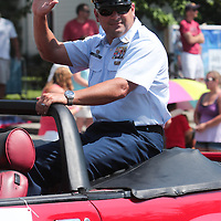 Parade Marshal BCMS A. Mark Kannon to spectators during the North Carolina 4th of July Festival Parade Friday July 4, 2014 in Southport, N.C.