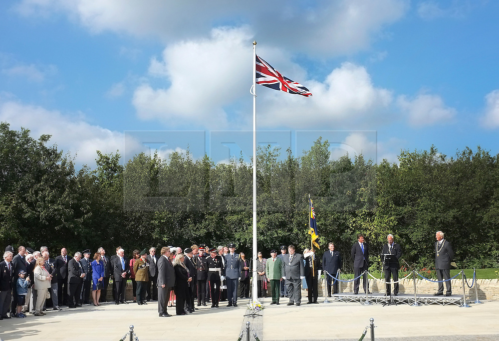 © licensed to London News Pictures. CARTERTON, UK.  01/09/11. A ceremony takes place at The Memorial Garden at Norton Way in Carterton, Oxfordshire today (01 Sept 2011). The Garden will become the focal point during the repatriation of UK service personnel from RAF Brize Norton. The Union Flag that used to fly at repatriations in Wooton Bassett was handed over and was blessed. . Mandatory Credit Stephen Simpson/LNP