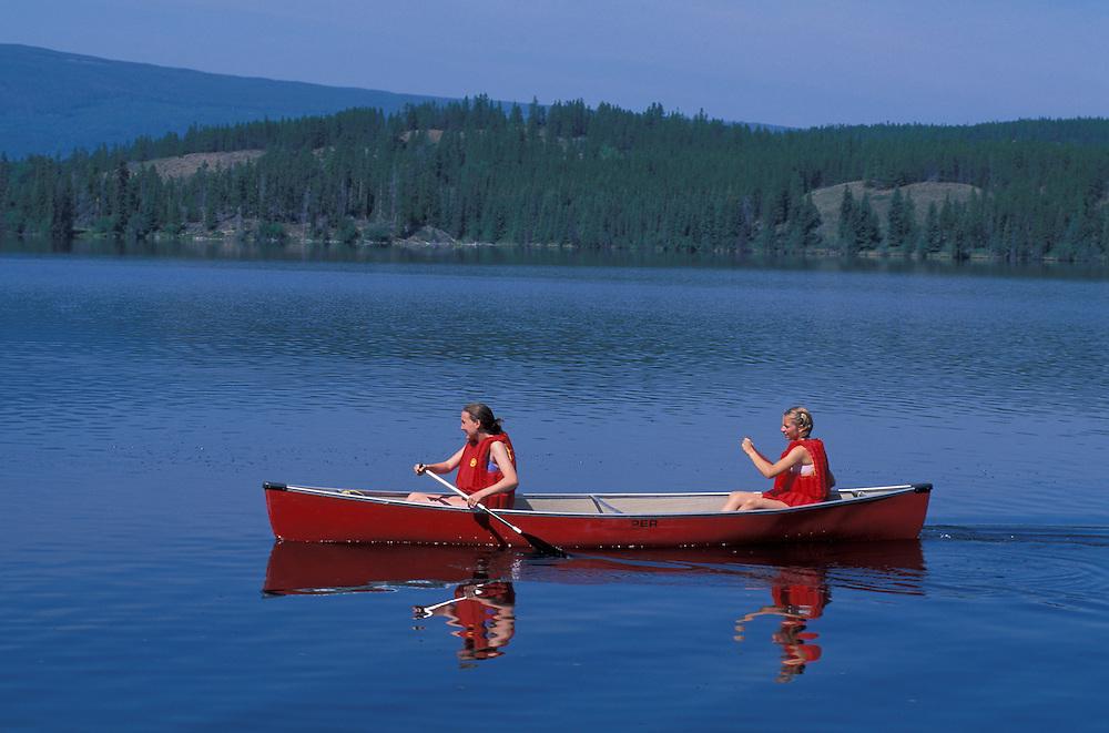 Girls in Canoe on Clearwater Lake, Kleena Kleene, Chilcotin Country,British Columbia,Canada