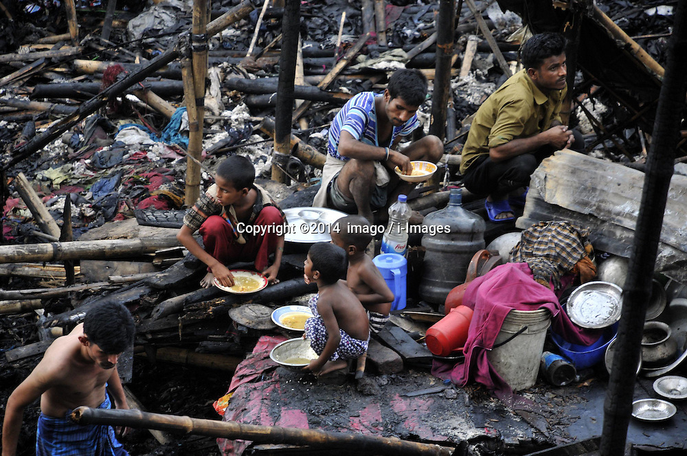 Image &copy;Licensed to i-Images Picture Agency. 28/06/2014. 61774758. Dhaka, Bangladesh. Bangladeshi slum dwellers search for their belongings after a big fire at Mirpur in Dhaka, Bangladesh. At least 450 shanties were destroyed in the fire, local police said. Picture by  imago / i-Images<br /> UK ONLY