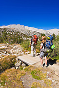 Backpackers on trail in Little Lakes Valley, John Muir Wilderness, Sierra Nevada Mountains, California