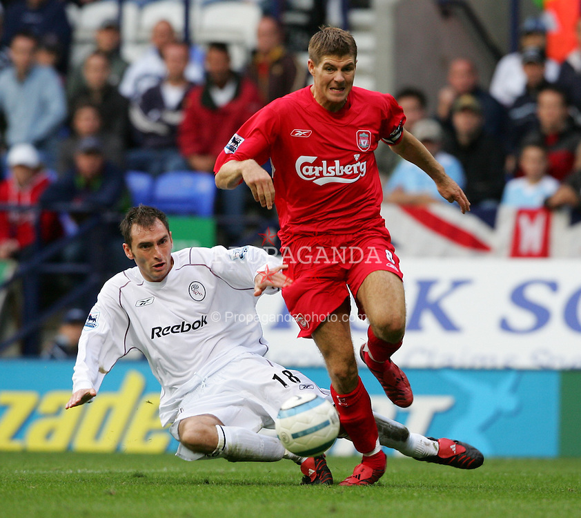 BOLTON, ENGLAND - SUNDAY AUGUST 29th 2004: Liverpool's Steven Gerrard and Bolton's Nicky Hunt during the Premiership match at the Reebok Stadium. (Photo by David Rawcliffe/Propaganda)