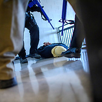 """McKinley County Sheriff's Deputies """"secure"""" an active shooter, played by Jerijah Triplett, District Fire Chief for Ft Wingate Fire Department during an Active Shooter training exercise at Wingate High School Friday."""