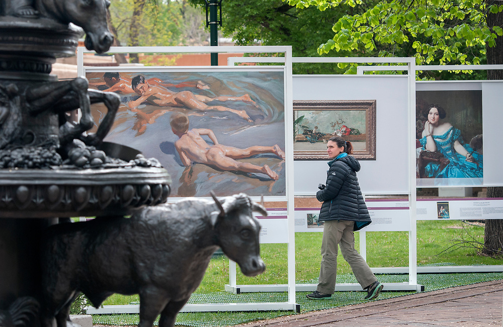 em051017a/jnorth/Alexandra Dinan-Mitchell, from Quebec Canada, looks through The PRADO in Santa Fe exhibit in Cathedral Park Santa Fe, Wednesday May 10, 2017. (Eddie Moore/Albuquerque Journal