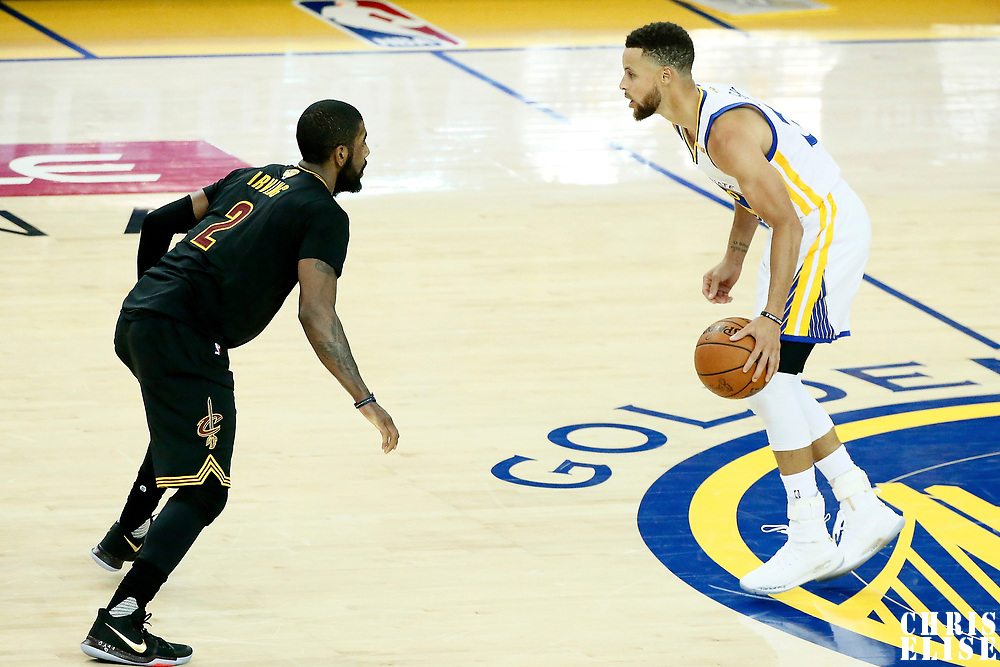 12 June 2017: Cleveland Cavaliers guard Kyrie Irving (2) defends on Golden State Warriors guard Stephen Curry (30) during the Golden State Warriors 129-120 victory over the Cleveland Cavaliers, in game 5 of the 2017 NBA Finals, at the Oracle Arena, Oakland, California, USA.