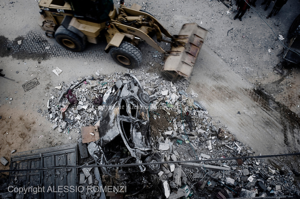 Gaza City: A digger cleans the road by rubbles in front of a house after was bombed by Israeli Air Force. November 17, 2012. ALESSIO ROMENZI
