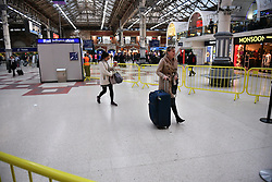 © Licensed to London News Pictures. 14/12/2016. London, UK. Passengers hoping to board a train, wait in a mainly empty Victoria Station on 14 December 2016, as hundreds of thousands of rail passengers face a second day of a 3 day all-out strike in an escalating dispute over the role of conductors between Southern Rail and the RMT Union. Photo credit: Ben Cawthra/LNP
