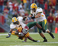 September 3, 2009: Iowa State running back Alexander Robinson (33) is hit by North Dakota State safety Daniel Eaves (7) and North Dakota State linebacker Matt Anderson (48) during the first half of the Iowa State Cyclones' 34-17 win over the North Dakota State Bison at Jack Trice Stadium in Ames, Iowa on September 3, 2009.