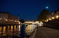 Paris, banks of the river Seine at night.
