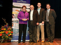 Mariam and Bob Smith receive the James R. Irwin Sr. Award from Chris Irwin and Kevin Skarupa WMUR during the 2015 Lakes Region Chamber of Commerce Community Hero Awards at the Winnipesaukee Playhouse on Tuesday evening.  (Karen Bobotas/for the Laconia Daily Sun)