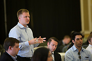Andrew Hohman asks the panelists a question at the Darren Butler Sports Business Forum on September 22, 2017.