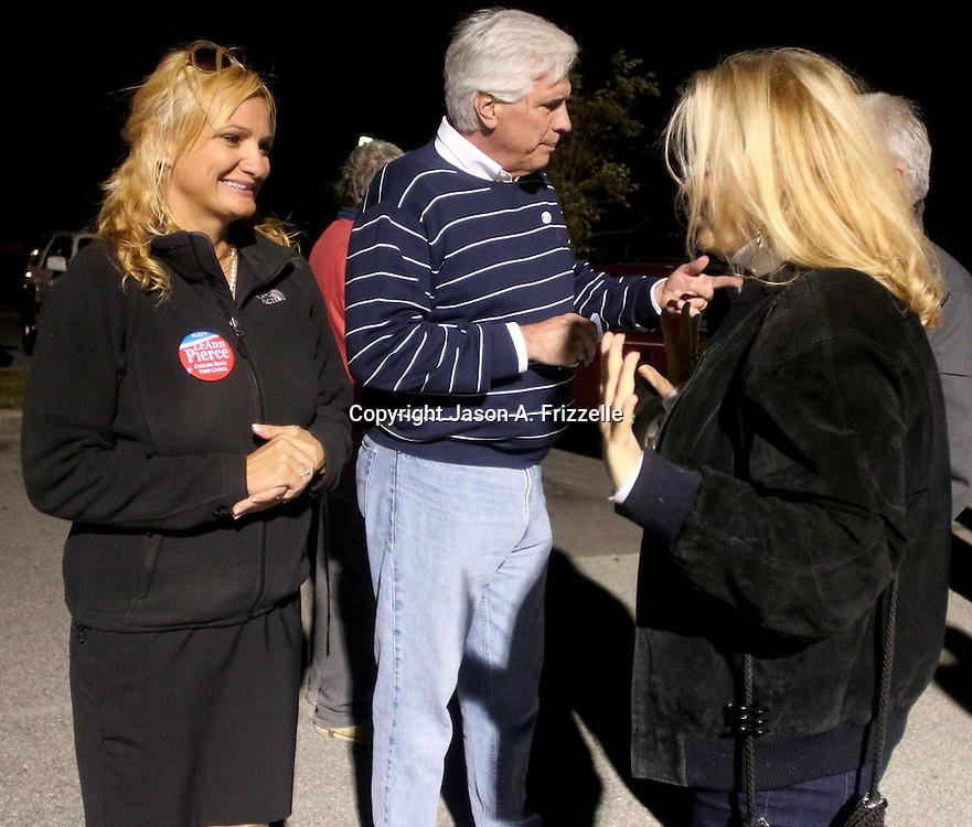 Candidate for Carolina Beach Town Council LeAnn Pierce talks to a voter outside of the Carolina Beach Recreation Center November 5, 2013. (Jason A. Frizzelle)
