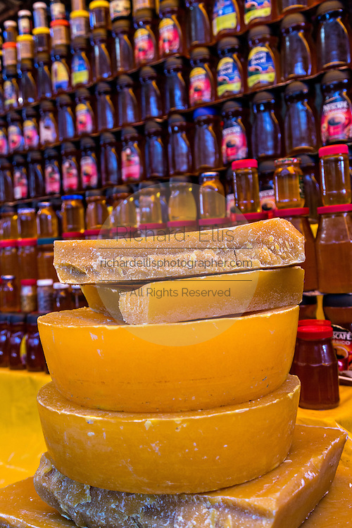 Beeswax and honey at Benito Juarez market in Oaxaca, Mexico.