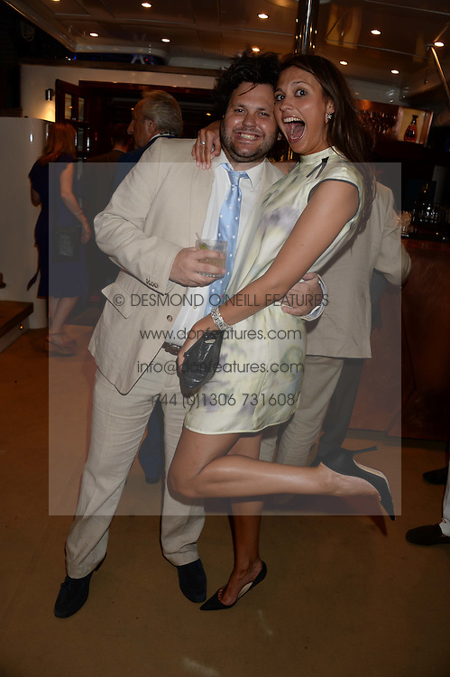 The Johnnie Walker Blue Label and David Gandy Drinks Reception aboard John Walker & Sons Voyager, St.Georges Stairs Tier, Butler's Wharf Pier, London, UK on 16th July 2013.<br /> Picture Shows:-Harry Cole, Olivia Cole,