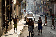 Group of men playing basketball on the streets of Havana, Cuba on Sunday June 29, 2008.