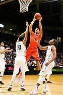 January 2nd, 2014:  Oregon State Beavers sophomore guard/forward Victor Robbins (1) shoots the ball over Colorado Buffaloes freshman forward Dustin Thomas (13) and sophomore forward Xavier Johnson (2)in first half action of the NCAA Basketball game between the Oregon State Beavers and the University of Colorado Buffaloes at the Coors Events Center in Boulder, Colorado