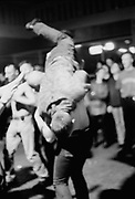 Man doing a flip on the dance floor, Russia, 2003