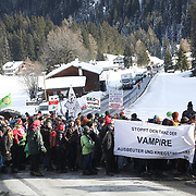 The third and last day of the Strike WEF march on Davos, 19th of January 2020, Switzerland. The march is coming off the path to cross the main road to Davos. The authorities had refused perission for the march to walk on the road into Davos so many hiked across the mountains from Klosters to get there. The march is a three day protest against the World Economic Forum meeting in Davos. The activists want climate justice and think that The WEF is for the world's richest and political elite only.