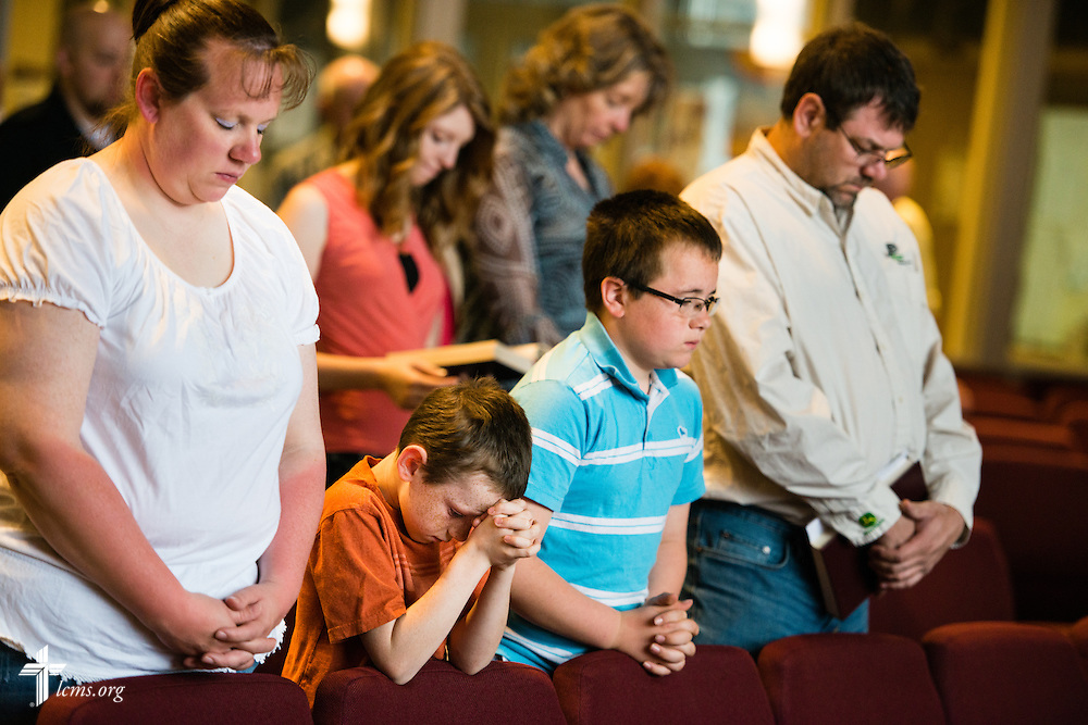 A family prays during worship on Sunday, April 12, 2015, at Mount Calvary Lutheran Church in Holdrege, Neb. LCMS Communications/Erik M. Lunsford