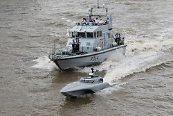 © Licensed to London News Pictures. 05/09/2016. LONDON, UK.  Bladerunner with HMS Anchor on the River Thames. The Royal Navy test out Bladerunner, their new prototype high speed drone speedboat on the River Thames in London this afternoon ahead of a major exercise. It is part of the Royal Navy's Unmanned Arrior program, which seeks to find an edge in the field of naval combat.  Photo credit: Vickie Flores/LNP