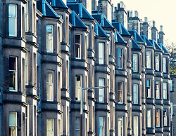 Detail of row of sandstone terraced apartments (tenements) on Comely Bank Avenue in Edinburgh, Scotland, United Kingdom