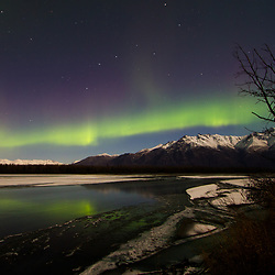 The aurora appears over Alaska's Knik River.