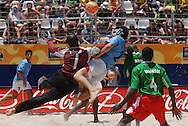 Football-FIFA Beach Soccer World Cup 2006 - Group C-CAM_URU - Seba-URU- receives a caress of Pascal Mbeyo-CAM-. - Rio de Janeiro - Brazil 06/11/2006<br />Mandatory credit: FIFA/ Marco Antonio Rezende.