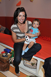 TV presenter MELISSA PORTER and her son PIERCE at a party to celebrate the opening of Purple Dragon - A new family members club at Grosvenor Waterside, 30 Gatliff Road, London SW1 on 29th September 2011.