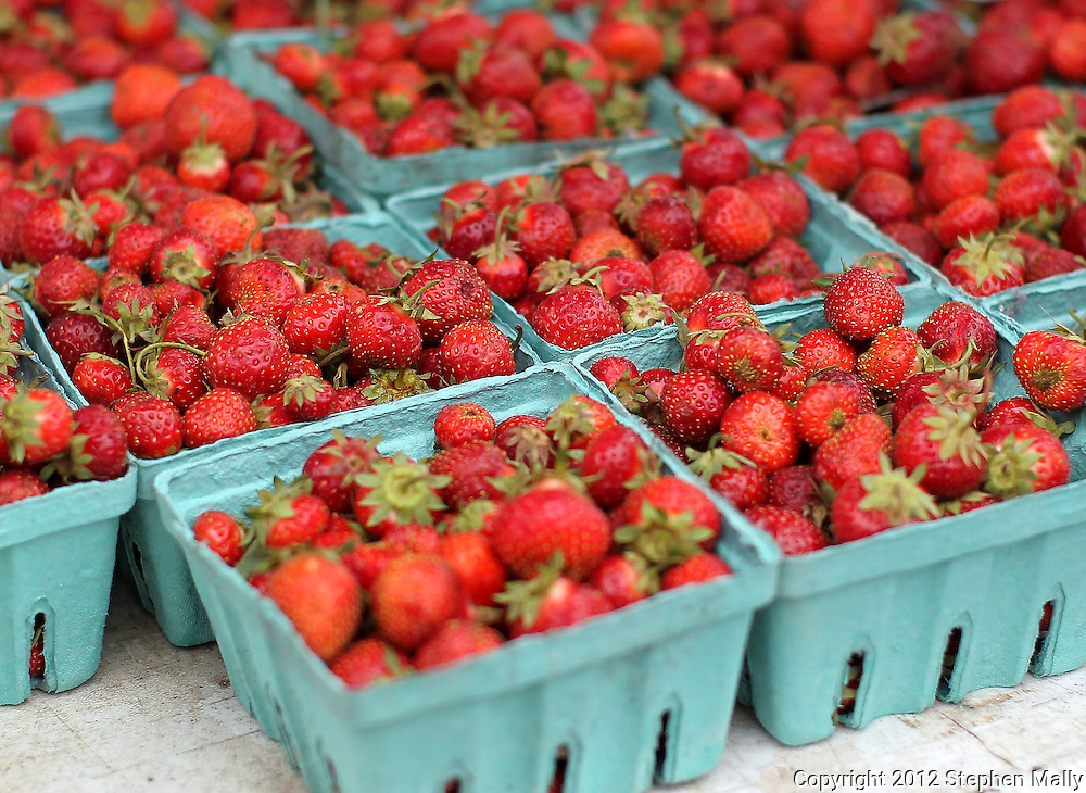Fresh strawberries for sale at the Downtown Farmers' Market in Cedar Rapids on Saturday morning, June 2, 2012. There were 244 vendors who participated in the first market of the year. (Stephen Mally/Freelance)