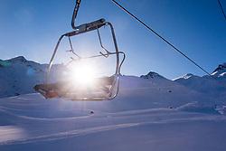 French Alps, Les Trois Vallées, Savoie, France. Sun Shining through Ski Lift Chair