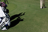 Pro Caddie, Ted Scott's shadow is highlighted by the sun as he places Bubba Watson's club back in the bag. Both caddie and PGA rookie where at the Pro Am that was held at Forest Oaks Country Club Monday, October 2, 2006 in Greensboro, NC.&amp;#xD;Photo by David Duncan&amp;#xD;<br />