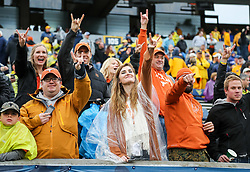 Nov 18, 2017; Morgantown, WV, USA; Texas Longhorns fans celebrate after beating the West Virginia Mountaineers at Milan Puskar Stadium. Mandatory Credit: Ben Queen-USA TODAY Sports