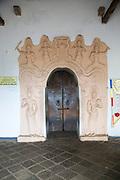 Decorated doorway entrance inside Dambulla cave Buddhist temple complex, Sri Lanka, Asia