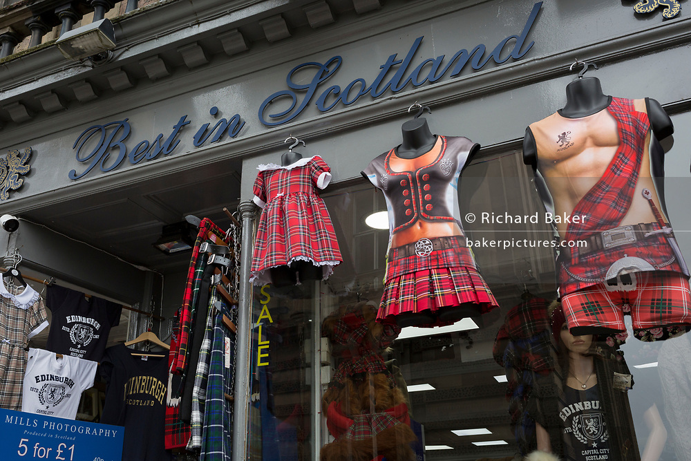 Tartan kilt T-shirts on sale in a tourist shop in Edinburgh, on 25th June 2019, in Edinburgh, Scotland.
