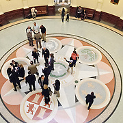 Visitors to the Texas State Capitol congregate in the central foyer directly under the dome of the building. As the home of the Texas state legislature, the building typically sees thousands of visitors a day for business and tourism.