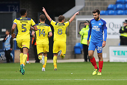 Michael Doughty of Peterborough United cuts a dejected figure as Oxford United celebrate their third goal - Mandatory by-line: Joe Dent/JMP - 30/09/2017 - FOOTBALL - ABAX Stadium - Peterborough, England - Peterborough United v Oxford United - Sky Bet League One