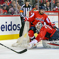 WASHINGTON, DC - FEBRUARY 09:  Washington Capitals goaltender Braden Holtby (70) makes a second period save on a shot by Columbus Blue Jackets right wing Cam Atkinson (13) as defenseman Matt Niskanen (2) eyes the loose puck on February 9, 2018, at the Capital One Arena in Washington, D.C.
