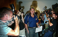 Australia's cricketing great Shane Warne is greeted by a throng of media at Melbourne Airport after landing from South Africa amidst a drug scandal when he tested positive to a banned diuretic tablet. Either side of the stunned Warne are the great photographers in Simon Schluter, left, and Jack Atley stalking him on the right. (Copyright Michael Dodge/Herald Sun)