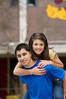 Teenage Boy Giving Girlfriend Piggy Back Ride